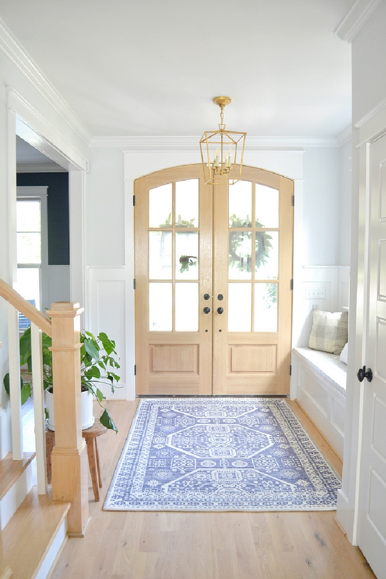 Sherwin Williams Extra White paint on trim in gorgeous modern farmhouse entry - Chrissy Marie Blog. #sherwinwilliams #extrawhite #brightwhitepaint #paintcolors #whitepaint #bestwhites #interiordesign