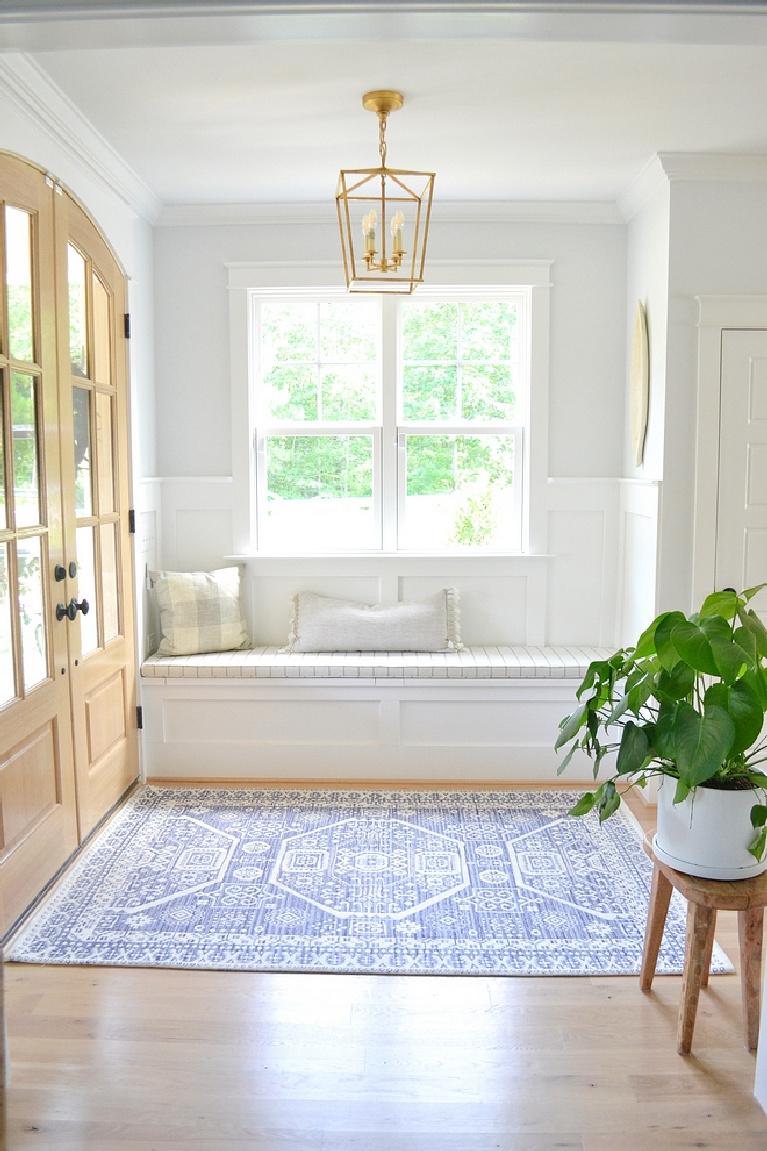 Sherwin Williams Extra White paint on trim in gorgeous modern farmhouse entry - Chrissy Marie Blog. #sherwinwilliams #extrawhite #brightwhitepaint #paintcolors #whitepaint #bestwhites #interiordesign