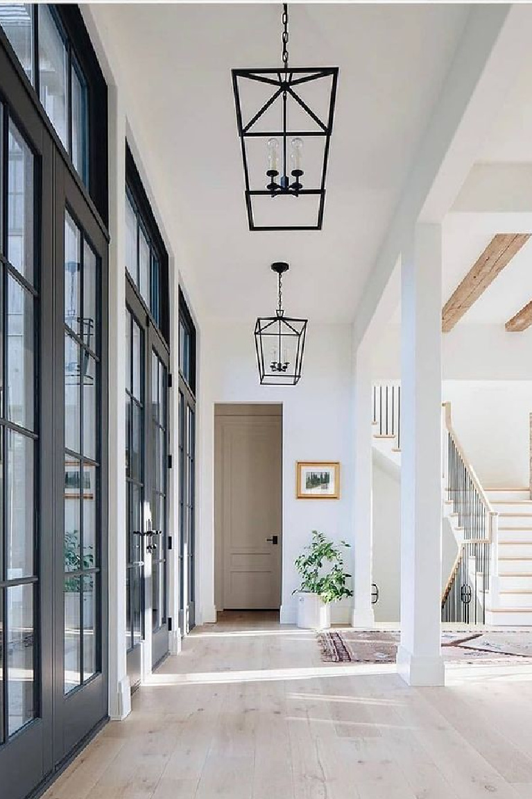 Pure White (Sherwin Williams) bright white paint color in a beautiful modern farmhouse hall - Kate Marker. #sherwinwilliamspurewhite #paintcolors #bestwhites #interiordesign