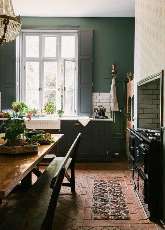 Deep green walls in an English country kitchen by deVOL kitchens. #englishcountry #kitchendesign #greenkitchen #devol #aga