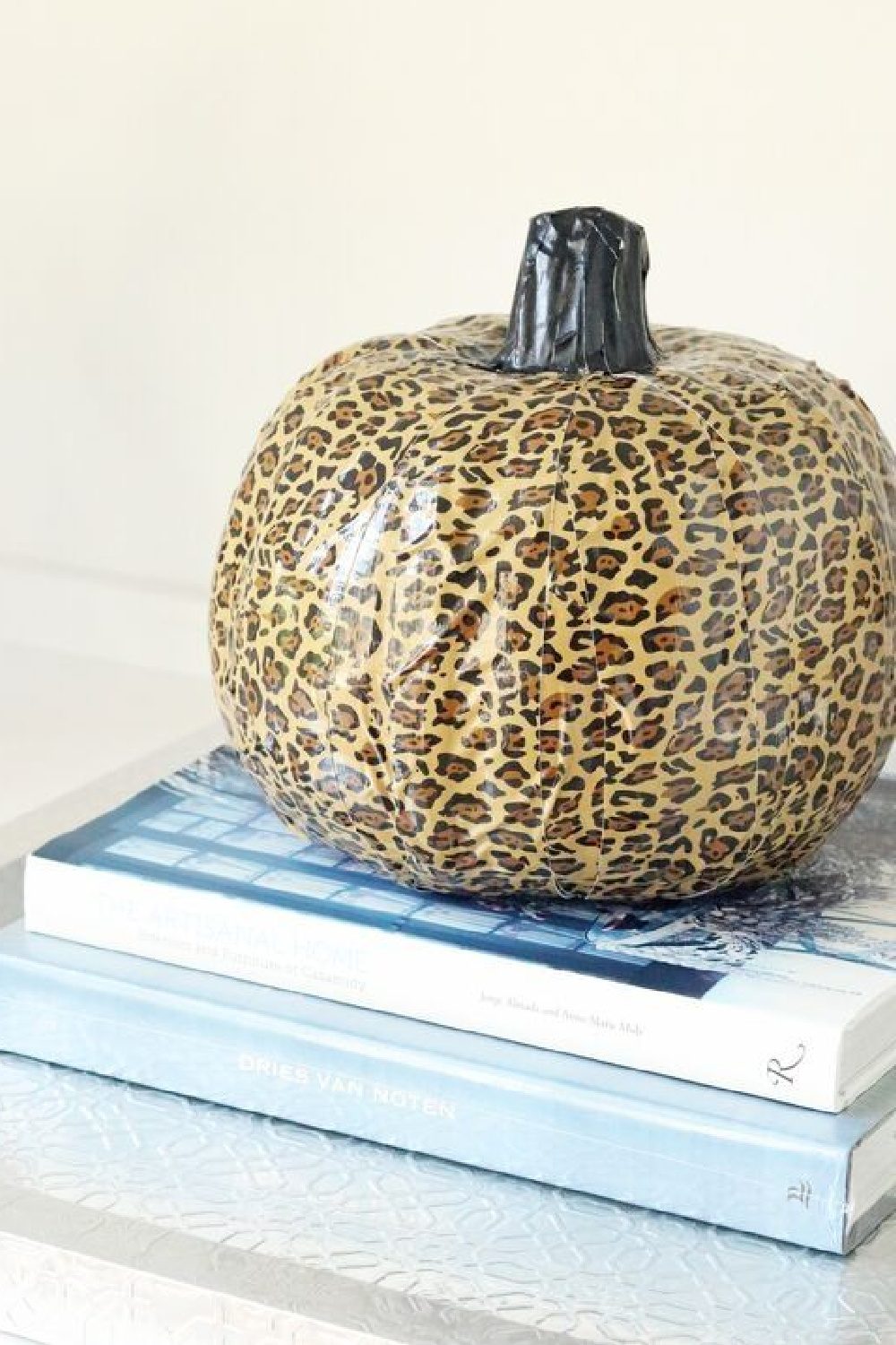 Leopard pumpkin DIY craft with duct tape - Passion for Savings. #fallcrafts #leopard #pumpkincraft #diy