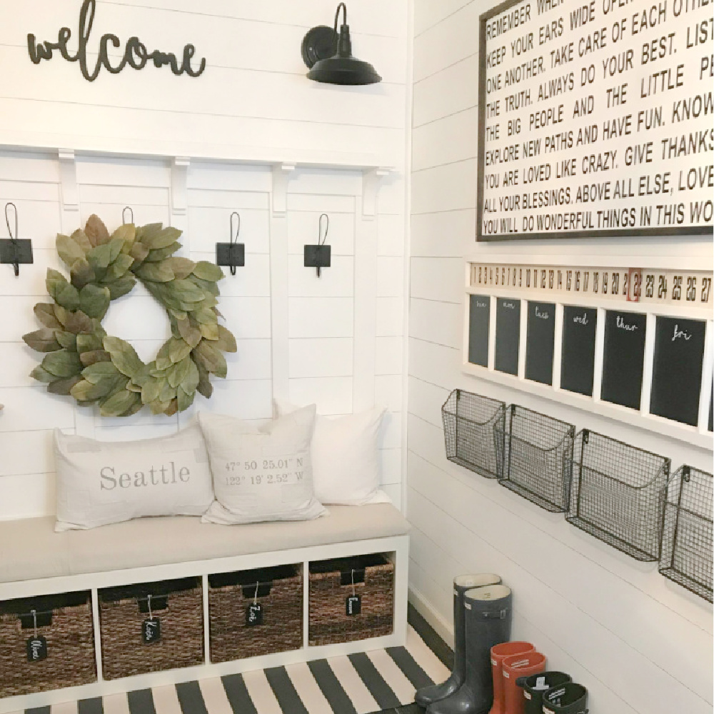 Ikea Kallax cubbies and bench in a farmhouse style mudroom area by Dreaming of Homemaking. #kallaxhack #mudroom #farmhousestyle