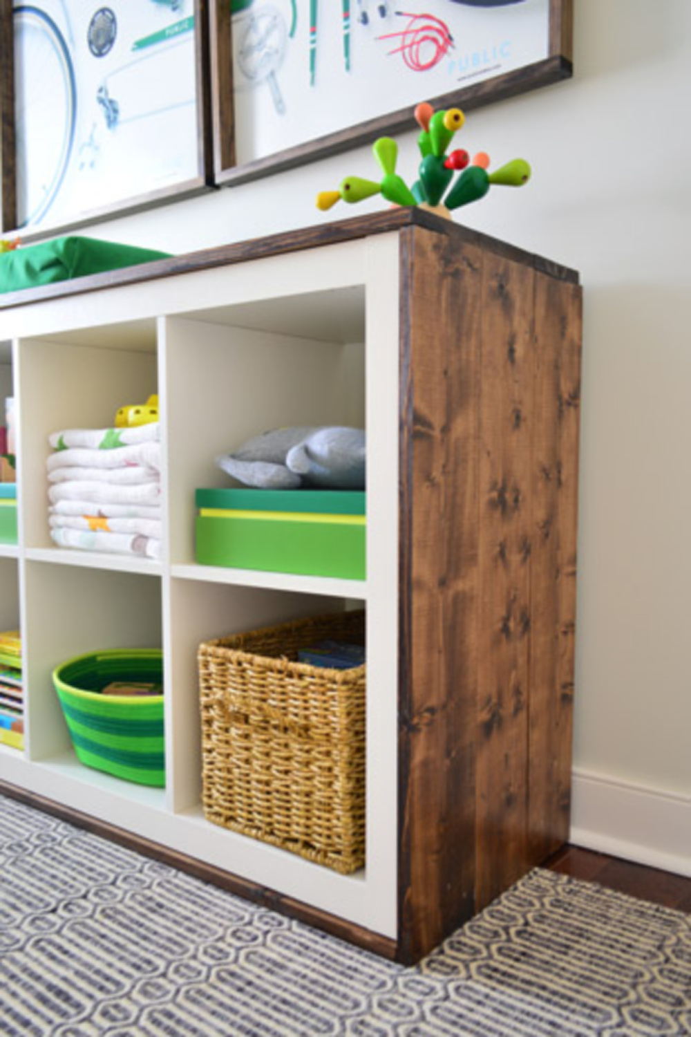 Kallax hack with changing table trimmed in wood - Young House Love. #kallaxhack #ikeahacks #nurserydesign #budgetdesign
