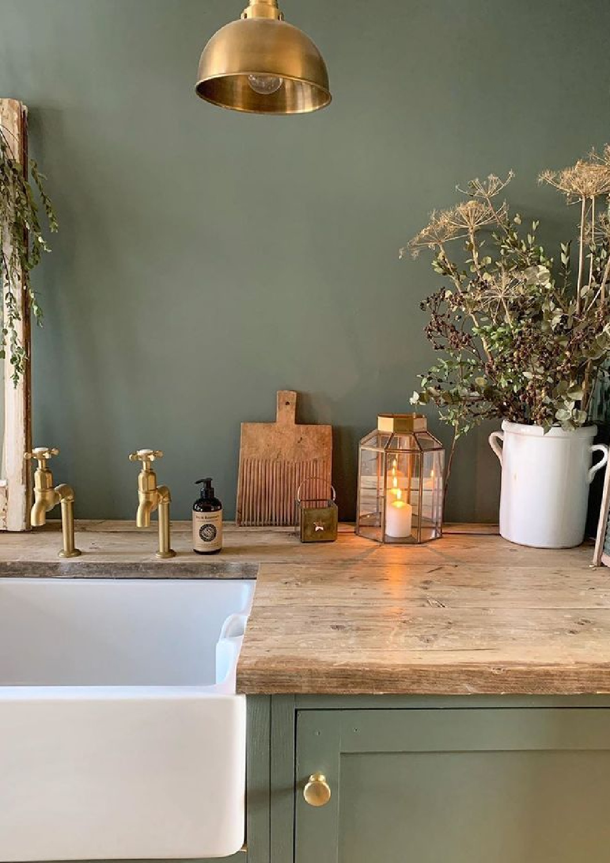Farrow & Ball Green Smoke on walls and cabinets of a laundry room by Simply Scandi Katie. #farrowandball #greensmoke #paintcolors #darkgreen #greenpaint