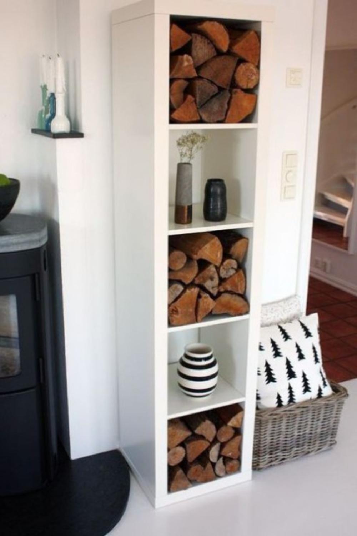 Kallax shelf for firewood storage and artful display. #ikeafurniture #kallaxshelf #kallaxhacks
