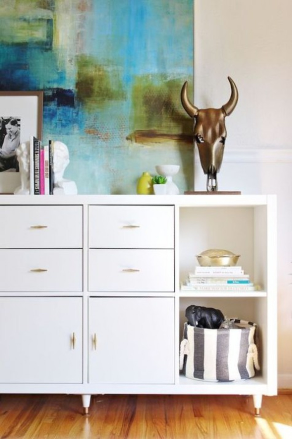 Dresser with Kallax in a bedroom for storage and display. #kallaxhacks #ikeahacks