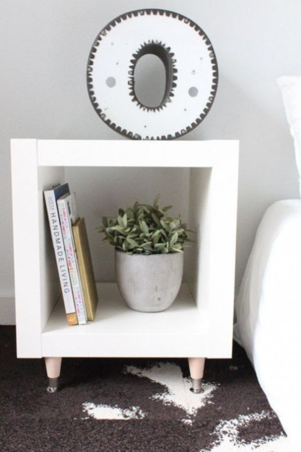Simple and minimal, Kallax is used as a nightstand and elevated with MCM feet. #kallaxhack #nightstands