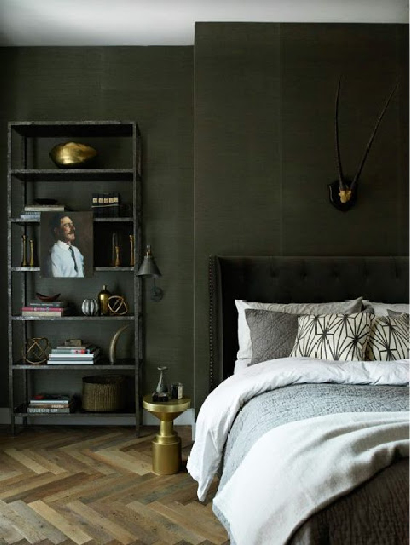 Gorgeous dark green walls in bedroom with herringbone floor on Hello Lovely. Come explore Dark Green Paint, Autumnal Greens & Interior Design Inspiration!