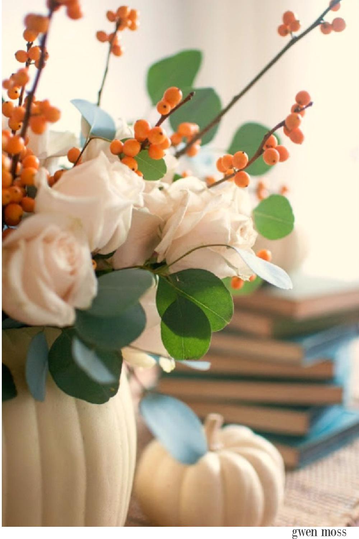 Gorgeous and simple fall centerpiece with white pumpkins, roses, bittersweet and eucalyptus - Gwen Moss. #falltable #pumpkincenterpiece #thanksgiving #tabledecor