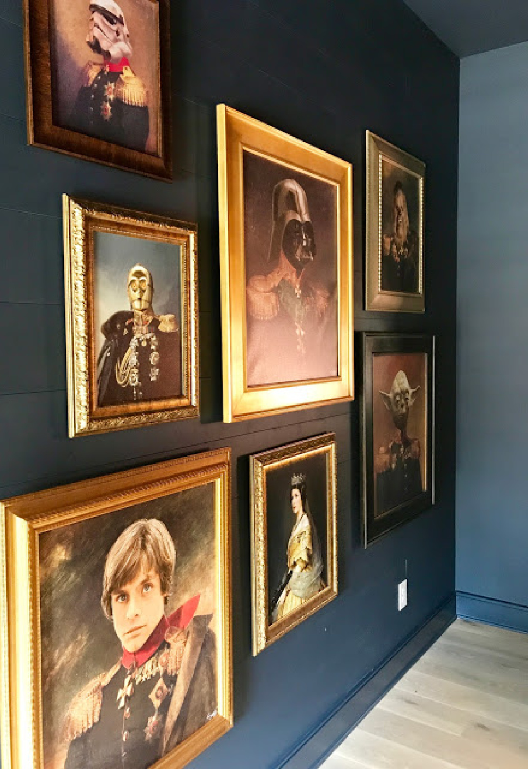 Hilarious Star Wars characters sit for oil paintings displayed on a gallery wall in a fun bedroom by Dana Lynch at the Pinewood Forest Idea House. Photo: Sherry Hart. #starwars #oilpaintings #whimsicaldecor #humor #artgallerywall #tealwalls #pineforestideahouse #atlantashowhouse