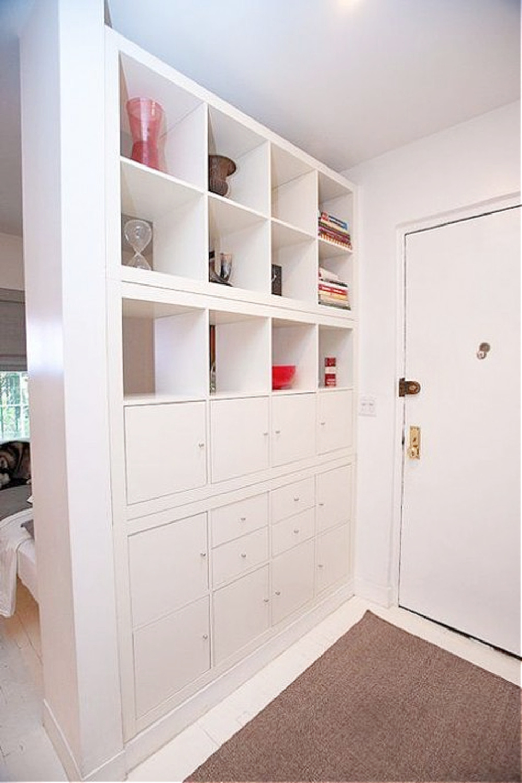 Kallax wall of storage to define an entry in an apartment. #kallaxhack #ikeakallax