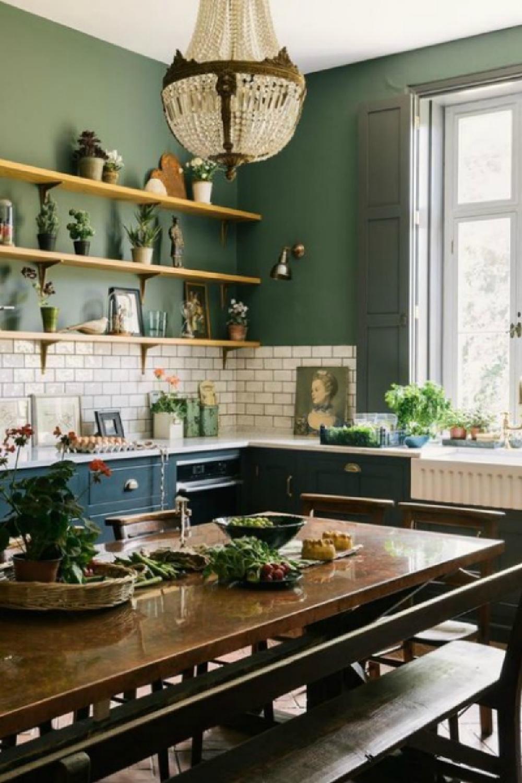 Gorgeous deep green walls in a bespoke farmhouse kitchen by deVOL kitchens - paint color is Ho Ho Green by Little Greene. #deVOLkitchens #englishcountry #greenkitchen #kitchendesign #darkgreenpaint