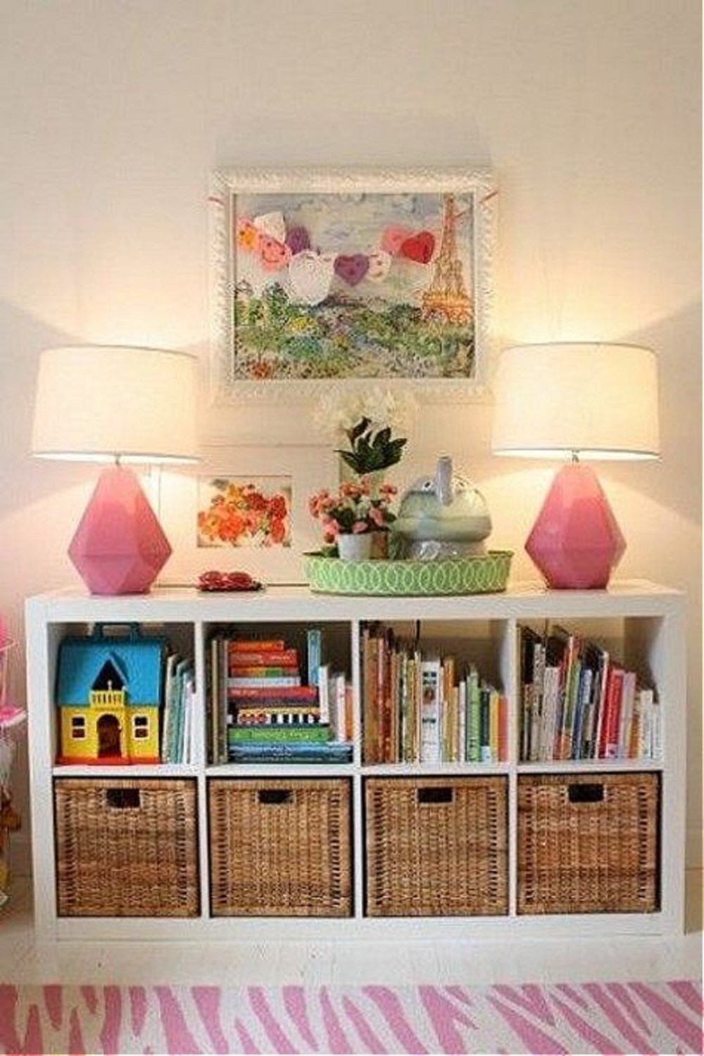 Horizontal storage in a play room with pink lamps and Kallax from Ikea. #kallaxhack