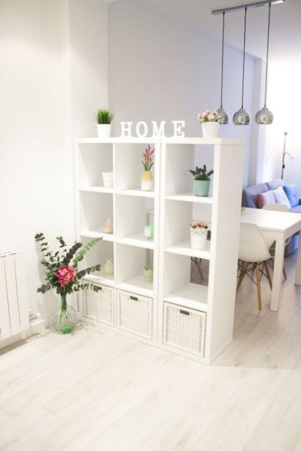 Airy room divider with Ikea's Kallax in a lofty space with white and sweet decor. #kallaxhack #roomdividers
