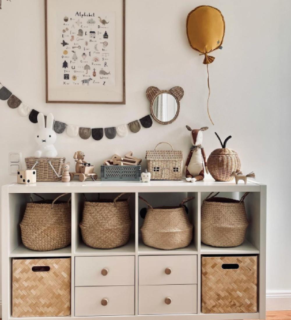 Kallax shelf hack in neutral nursery kids room with belly baskets and Scandi design - @__mamalina__. #ikeahacks #kallaxshelf #kidsroom