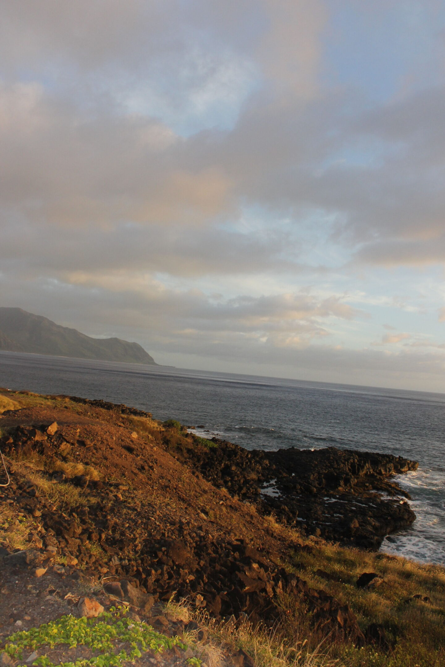 The glorious Pacific and mountainous landscape at Ka'ena Point on Oahu, where we hike to a seabird sanctuary to glimpse Laysan albatross beauty - Hello Lovely Studio.