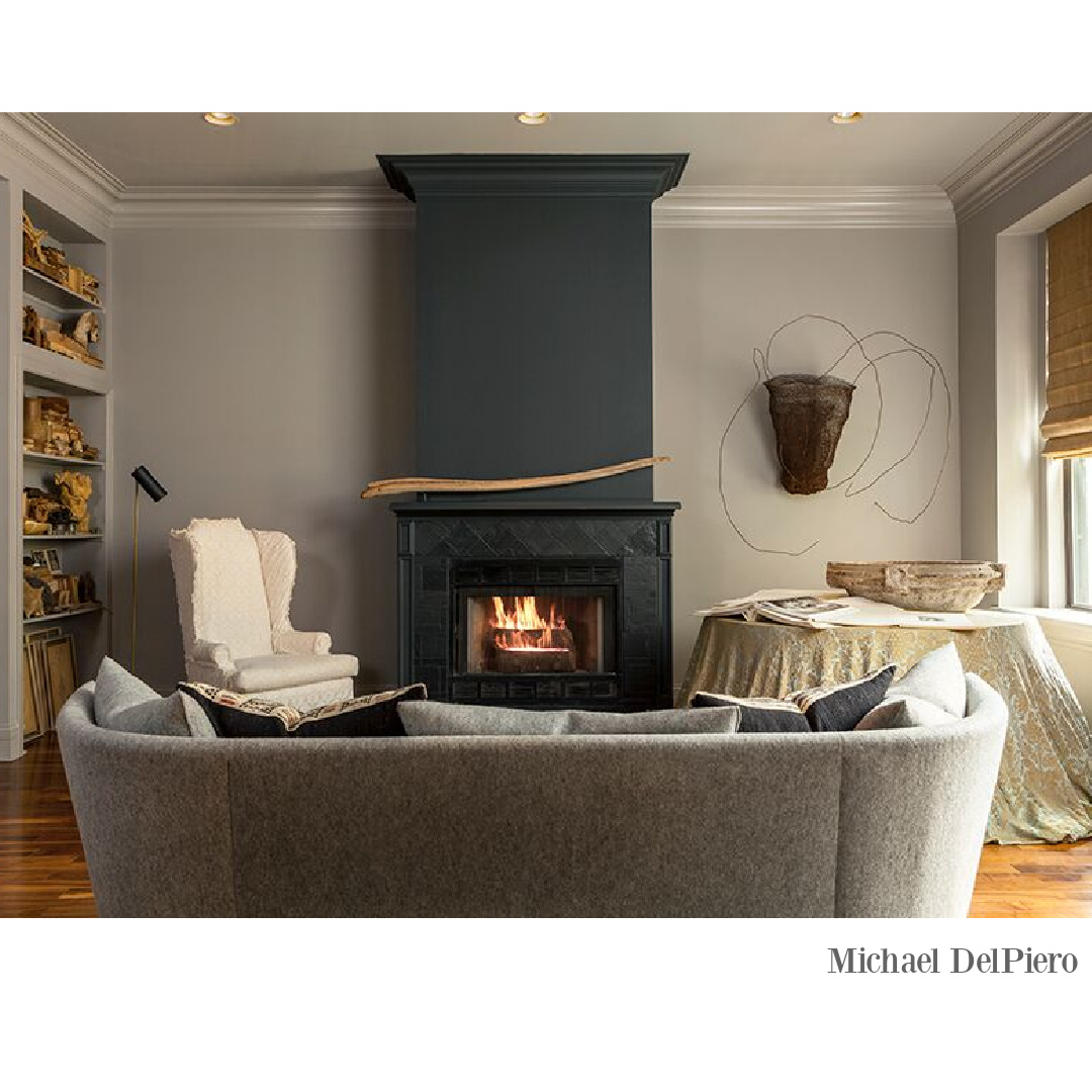 Modern rustic living room with black fireplace and eclectic neutral interior design by Michael DelPiero. #modernrustic #livingrooms