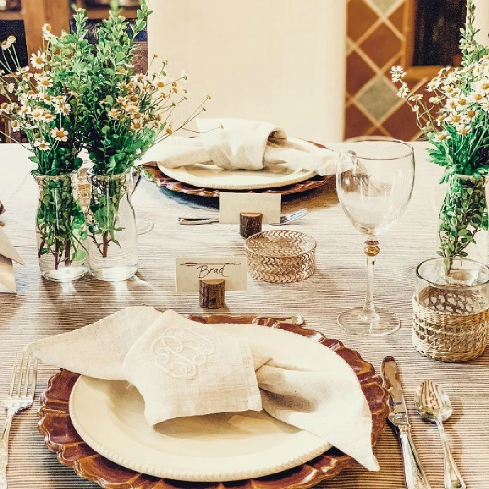 Breathtaking, rustic elegance with countless custom details and design by After Orange County at this outdoor wedding reception with unique tablescape decor! #weddings #tablescape #rusticelegance #outdoorwedding #placesetting #jutenapkins