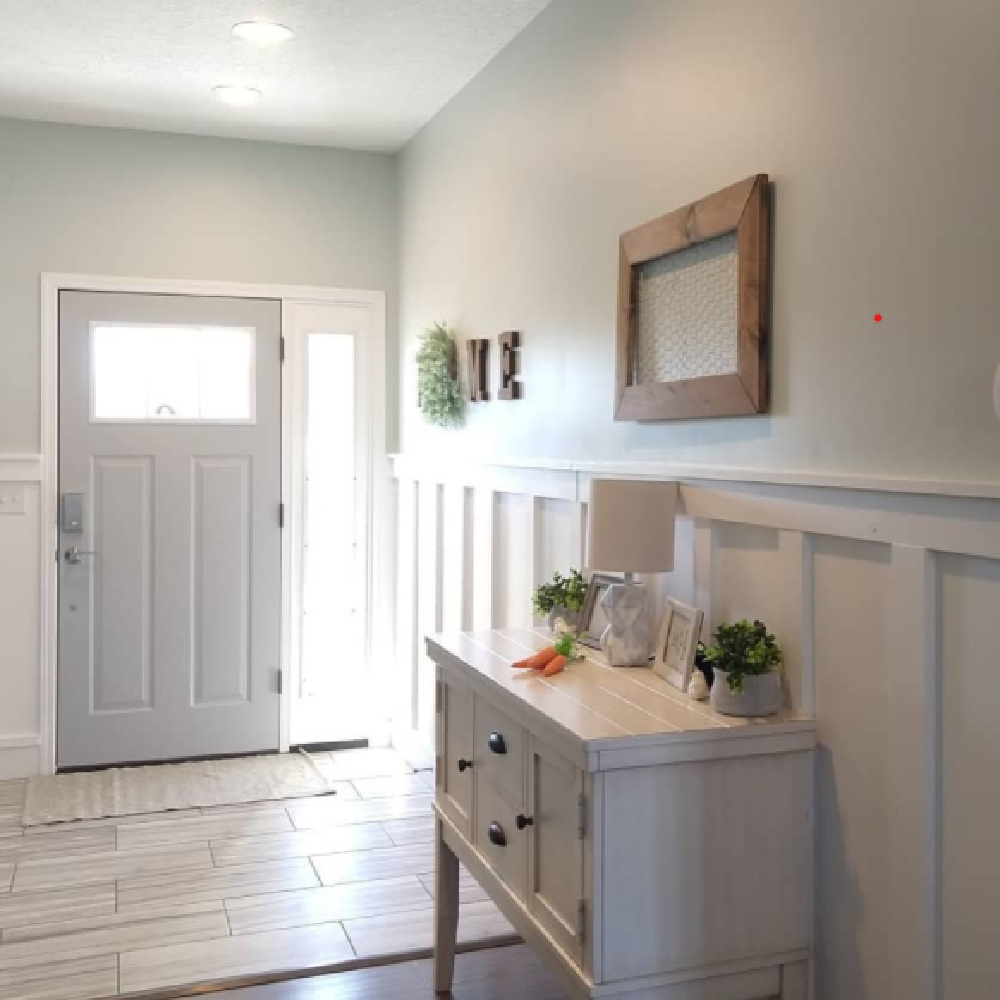 Classic Silver (Behr) on front door and upper walls in an entry with board and batten trim. #behrclassicsilver #greypaintcolors