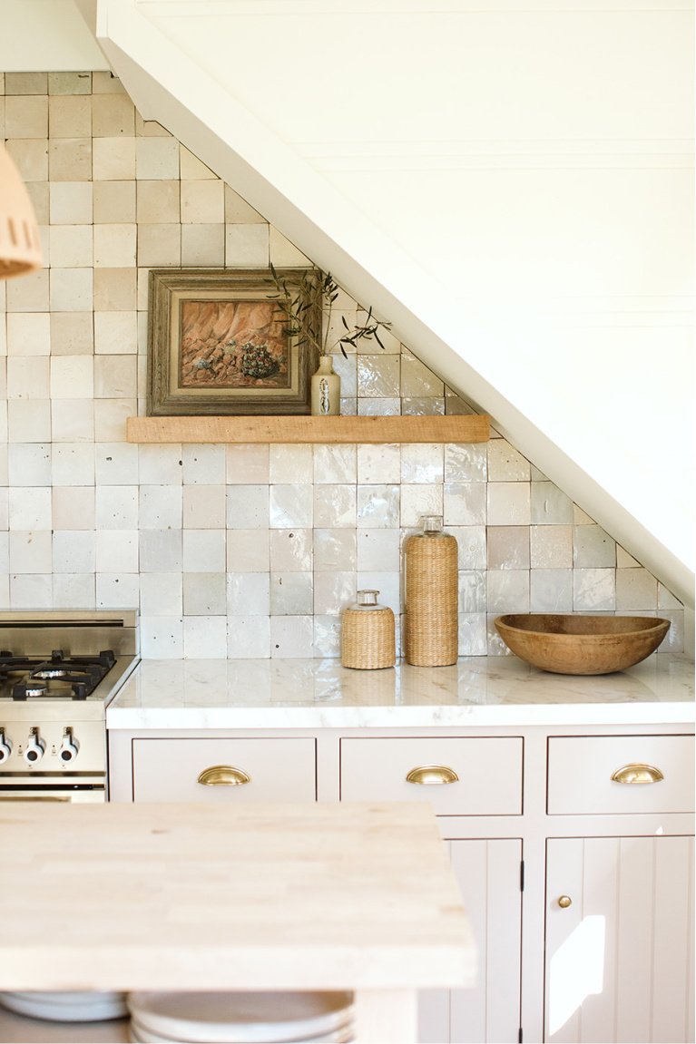 Gorgeous neutral timeless kitchen with putty colored cabinets and Zellige backsplash tile - Bodega House. #kitchendesign #puttycabinets #timelesskitchen #zellige #mushroom