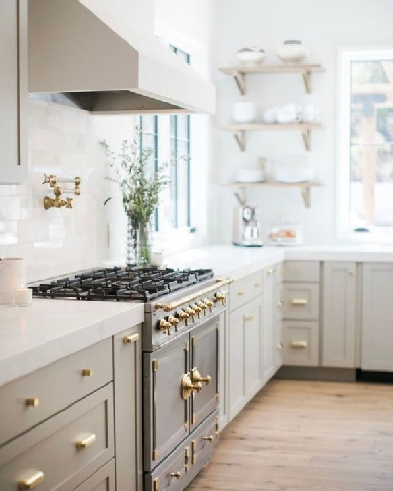 Lovely serene kitchen with putty or mushroom paint color on cabinets - @cherhousedesign. #kitchendesign #putty #greigecabinets #mushroom #neutralkitchens #serenekitchens