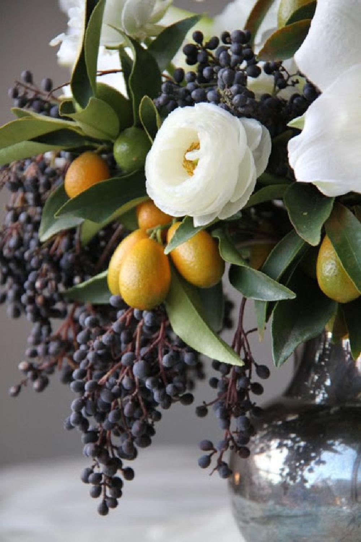 Gorgeous grapes in fall floral arrangement by Sarah Winward. #fallflowers #autumnfloral #floralarrangements