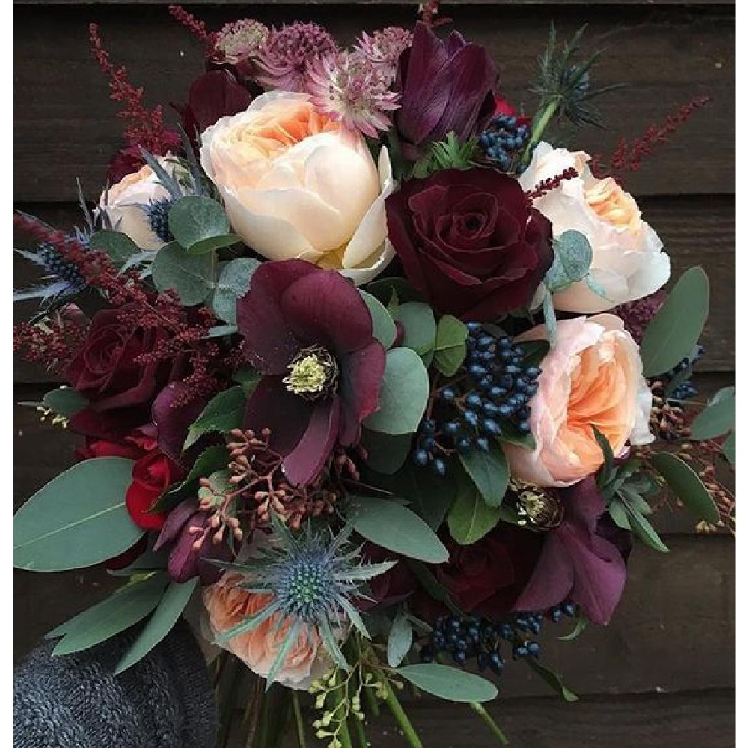 Rich burgundy, green and peach fall floral arrangement by Sarah Winward. Come explore Dark Green Paint, Autumnal Greens & Interior Design Inspiration!