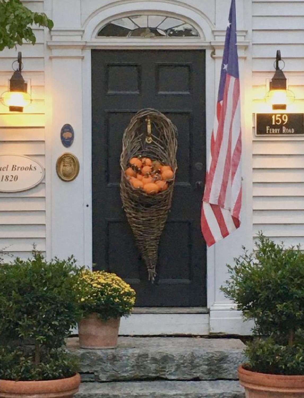 Fall front door of historic home - Nora Murphy Country House. #falldecor #frontdoor #fallporch