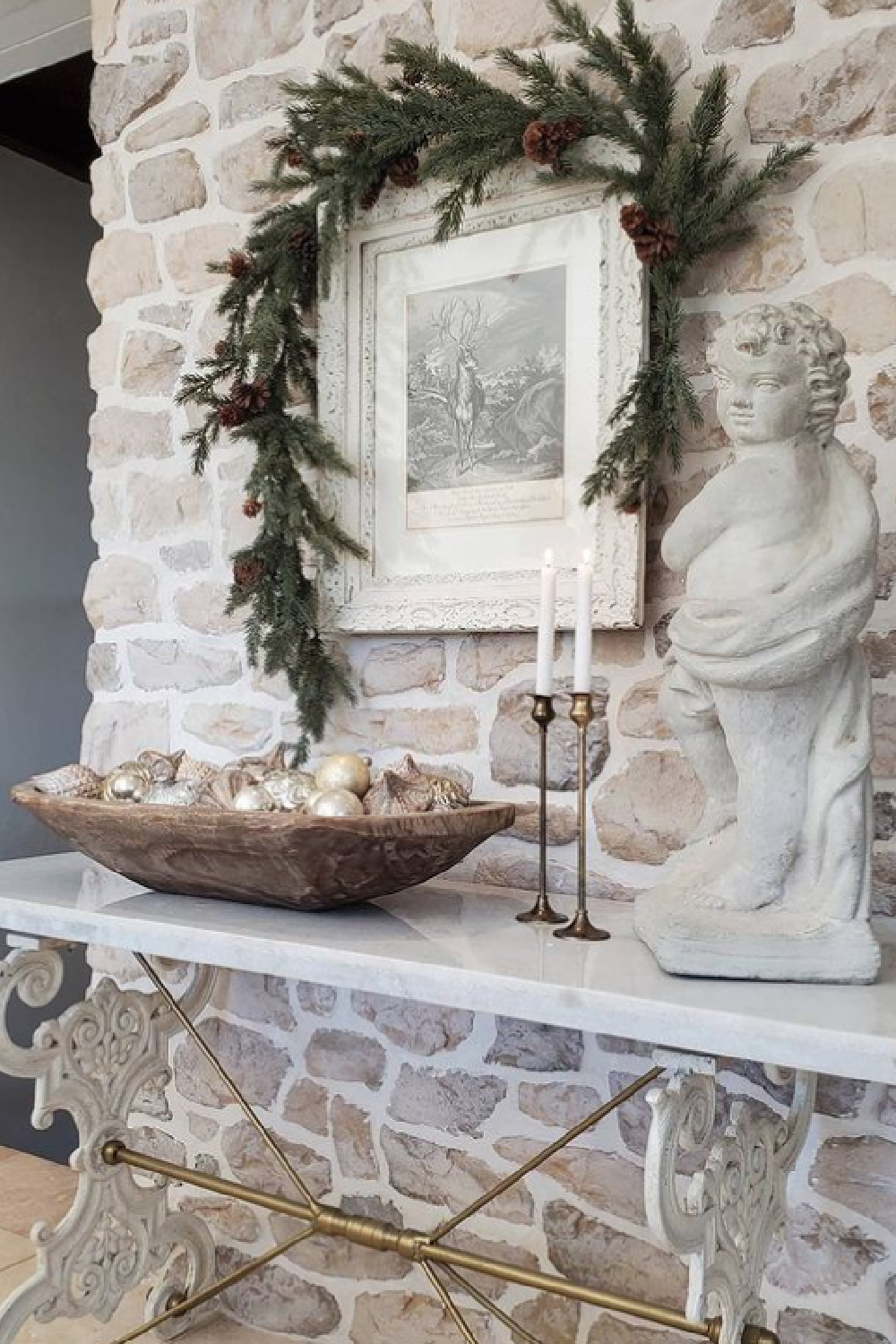 White French country Christmas decor with rustic stone, dough bowl with ornaments and cherub - The French Nest Co Interior Design.