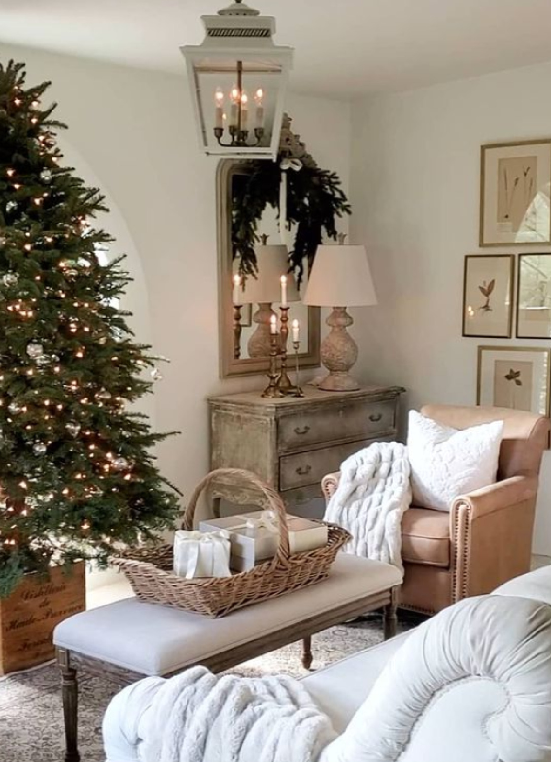 French country Christmas living room with tree, basket, and pale palette - The French Nest Co Interior Design