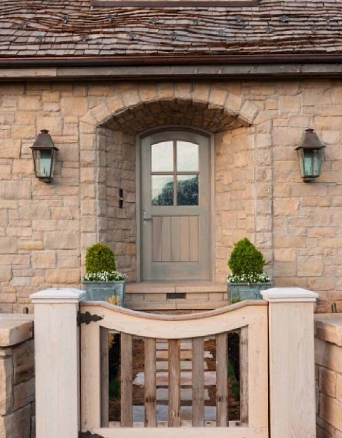 French country stone cottage arched entrance - design by Desiree Ashworth.