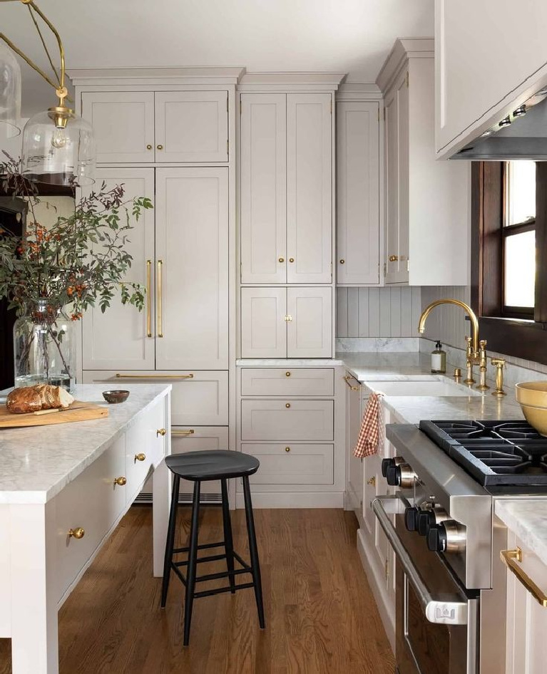 Breathtaking custom kitchen with putty kitchen cabinets - @heidicaillierdesign. #kitchendesign #kitchens #puttycabinets #serenekitchen #customkitchens