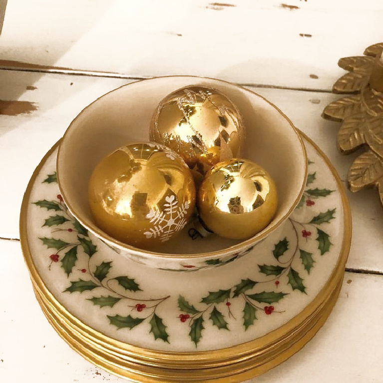Simple Christmas decor with vintage gold ornaments in Lenox Holly pattern bowl - Hello Lovely Studio.