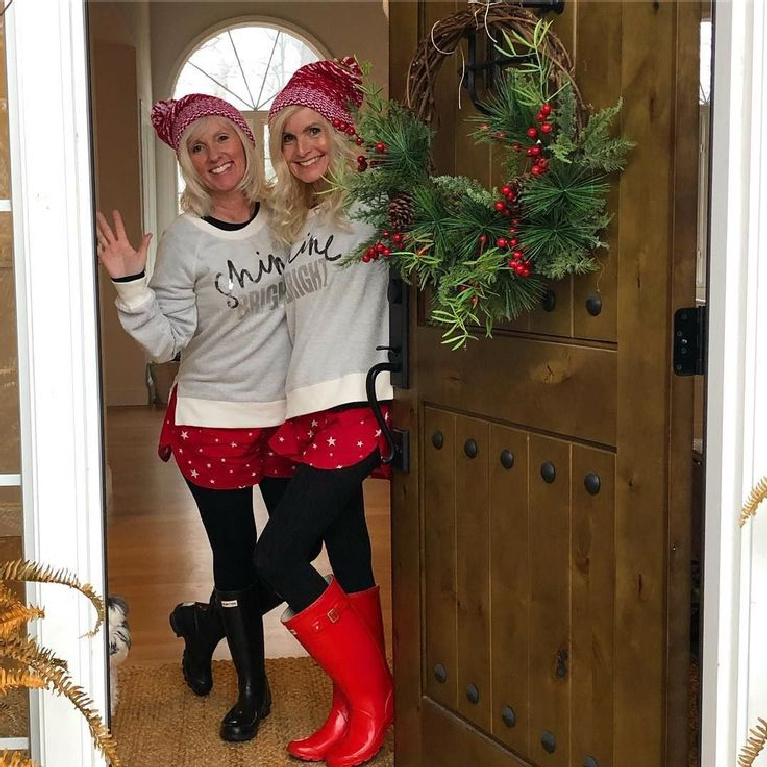 Hello Lovely Christmas joy at my front door with holiday wreath and me and sis dressed in festive wear. #hellolovelystudio #christmasdecor #christmaswreath #christmasdoor