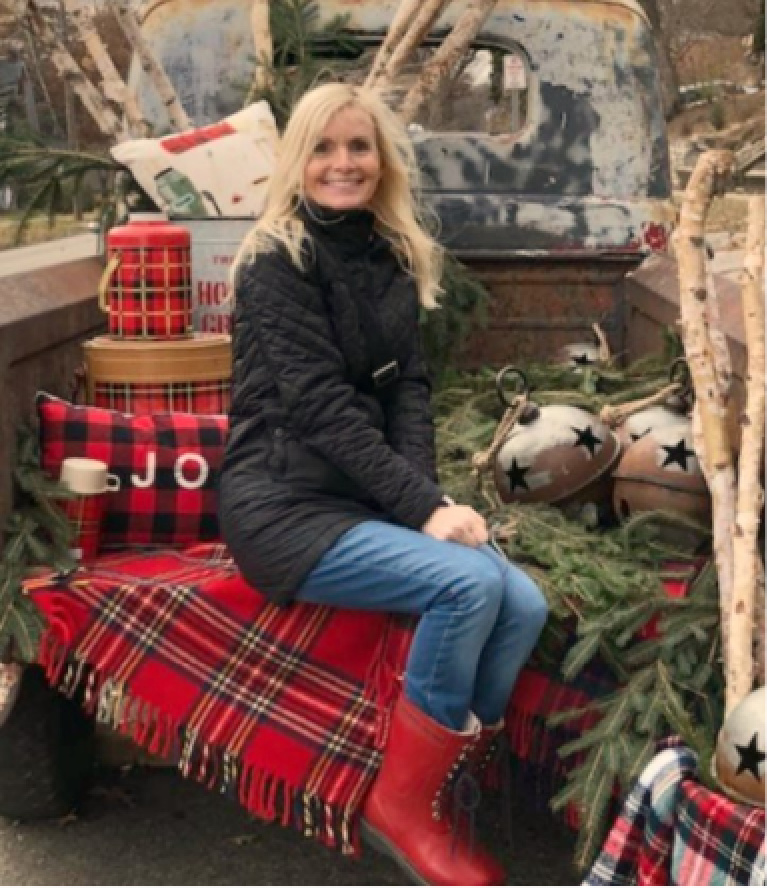 Farmhouse Christmas decor in a pickup with red plaid, vintage, bells, and thermoses at Urban Farmgirl - Hello Lovely Studio. #farmhousechristmas #vintagetruck #holidaydecor #hellolovelystudio