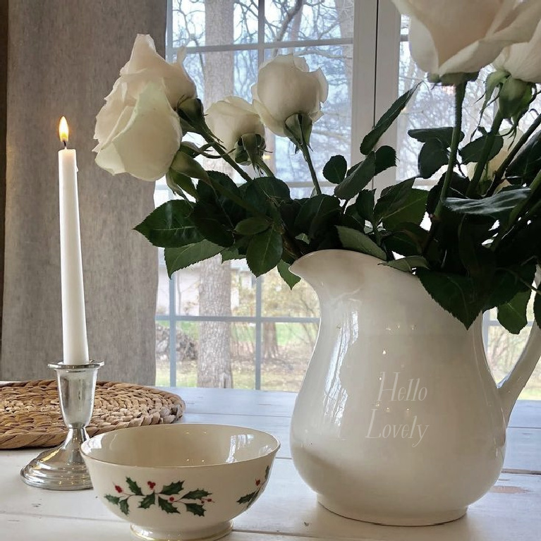 Hello Lovely Studio white Christmas pitcher with roses, Lenox Holly bowl and candle. #holidaydecor #whitechristmas #hellolovelystudio