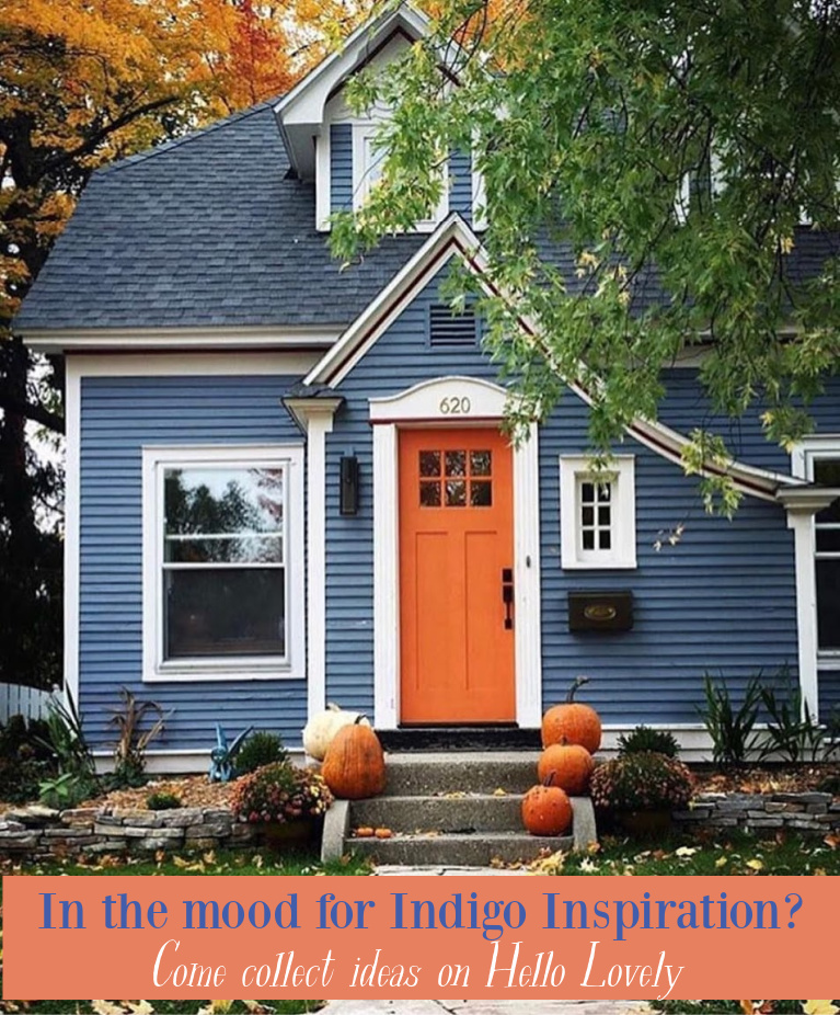 Pretty indigo blue Tudor cottage with orange door and pumpkins on the front steps in fall! Come discover more decor, paint colors, and interiors where indigo blue plays a starring role. #hellolovelystudio #indigoblue #bluedecor #bluepaintcolors #bluehouses #blueinteriors