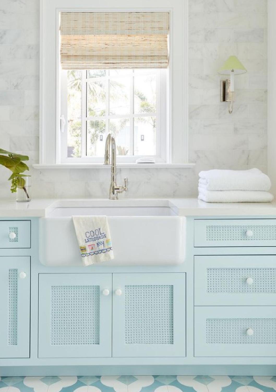 Pastel blue turquoise laundry room cabinets with marble subway backsplash, farm sink, and whimsical tile floor - KaraMillerInteriors. #laundryroom #turquoise #pasteldecor