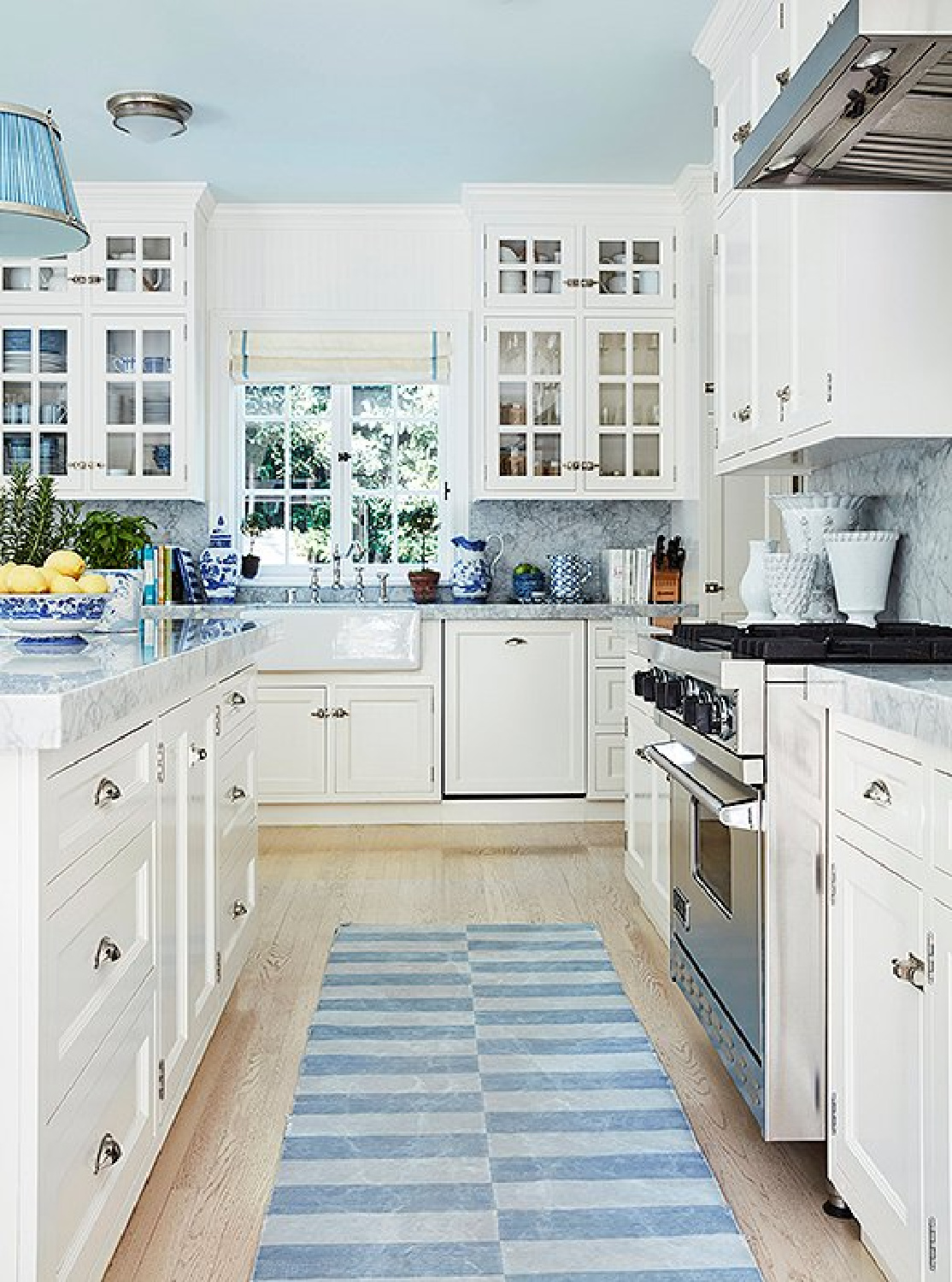 Beautiful blue traditional kitchen with white cabinets - design by Mark Sikes. #bluekitchen #blueandwhite #kitchendesign
