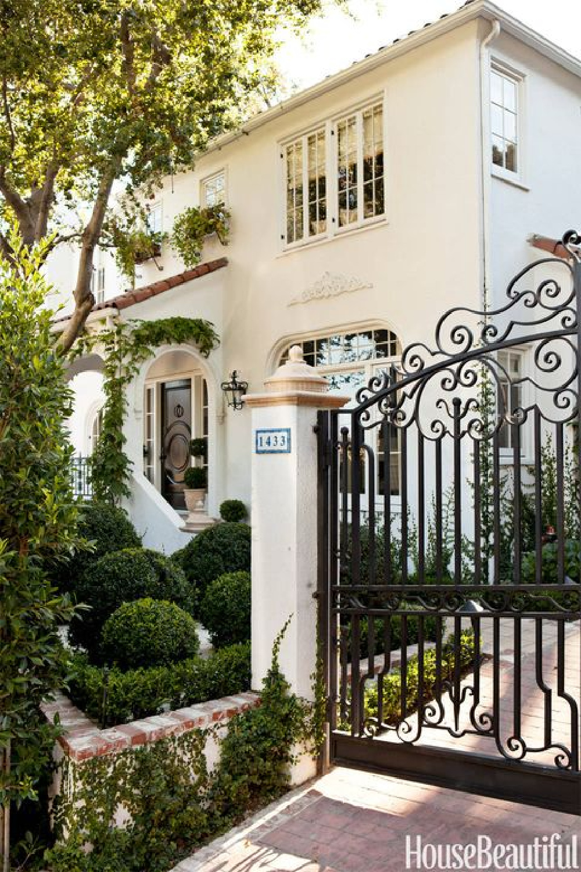 Beautiful Santa Barbara home exterior - Mark Sikes. #whitehouse #housexteriors #wroughtirongate
