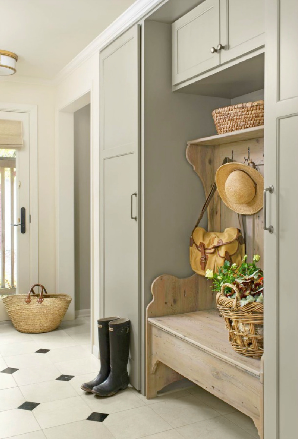 Beautiful mud room with custom built ins, farmhouse bench, and cozy design - Country Living, photo by Kimberly Gavin. Come enjoy Traditional Laundry Room and Mud Room Design Ideas, Resources, and Humor Quotes!