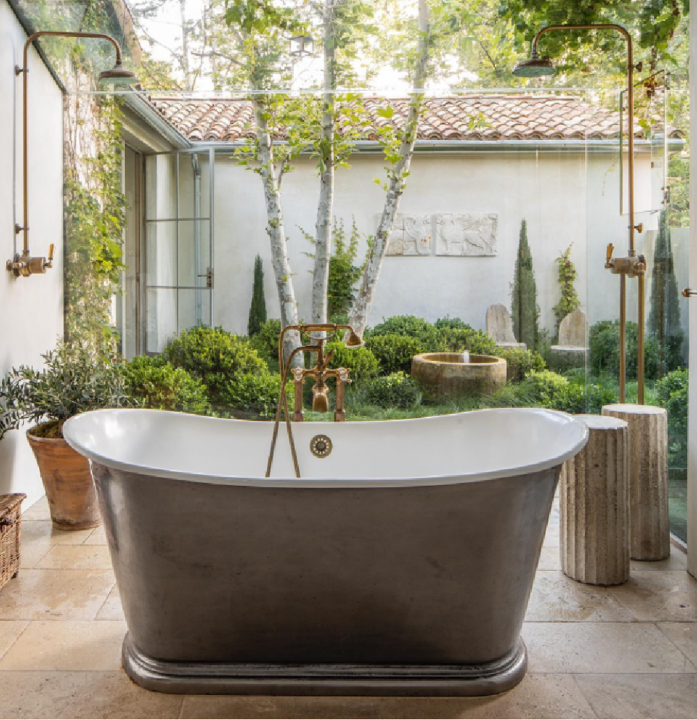 Patina Farm glass bathroom with soaking tub, double shower heads, and a glorious surrounding garden - Brooke Giannetti. #patinafarm #bathroomdesign #soakingtub