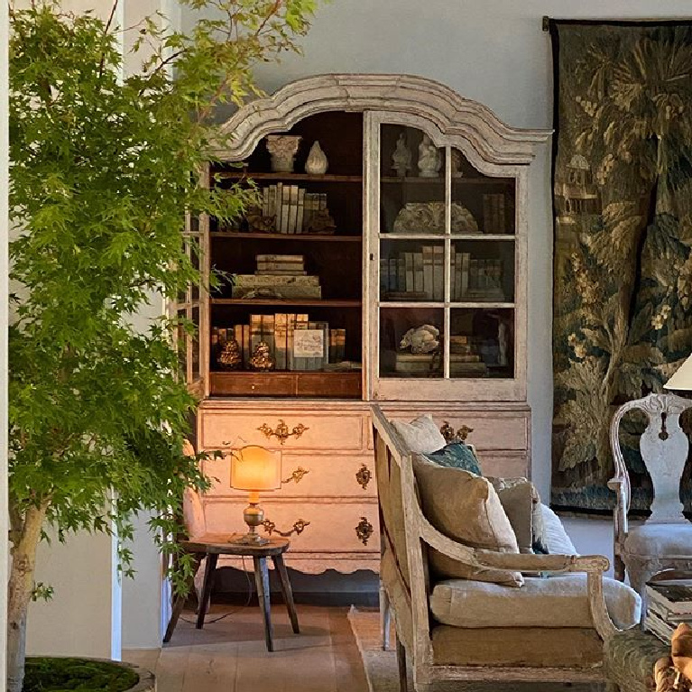 Patina Farm living room with Swedish Rococo antique cabinet, tapestry, European country furniture, and Old World charm - Giannetti Home.