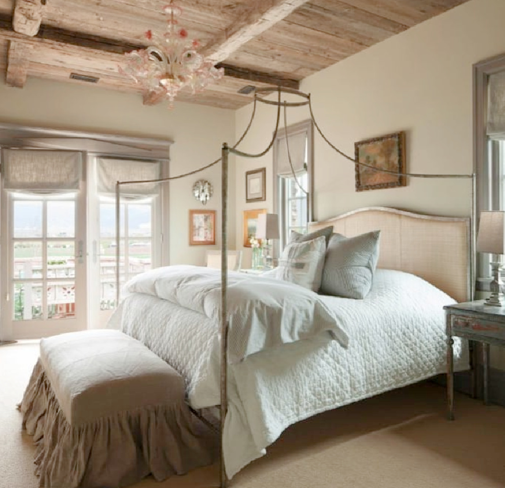 Romantically rustic elegant French country bedroom with raw rugged wood ceiling and poster bed - design by Desiree Ashworth. #frenchcountrybedroom #europeancountry