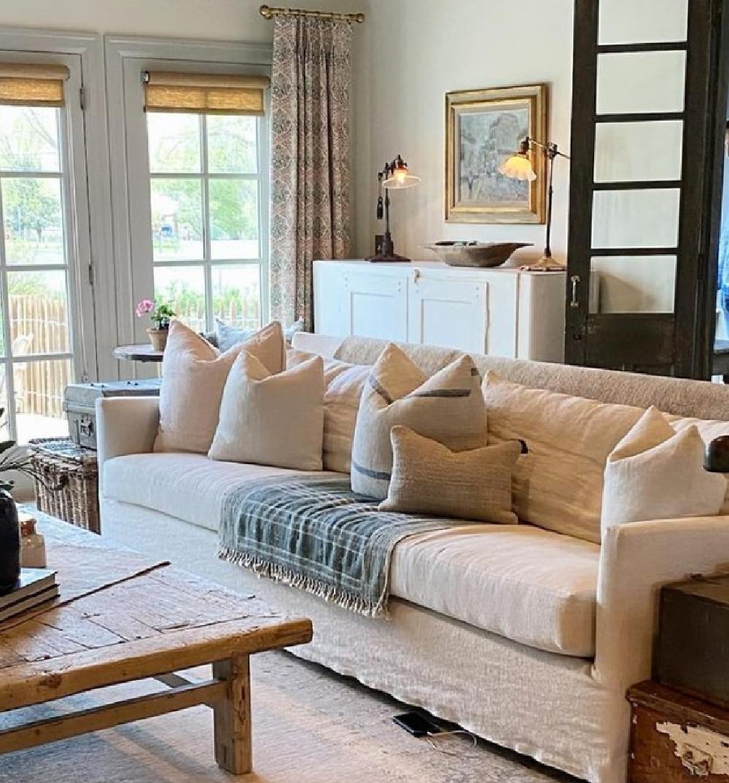 Rustic European country family room with Belgian linen sofa, black doors, and blue grey trim - @beljarhome. #europeancountry #belgianlinen