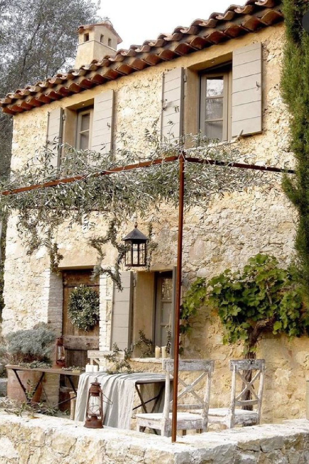Provence farmhouse with stone exterior, pergola and putty shutters - photo by Henri del Olmo. #frenchfarmhouse #provencefarmhouse #frenchcountry