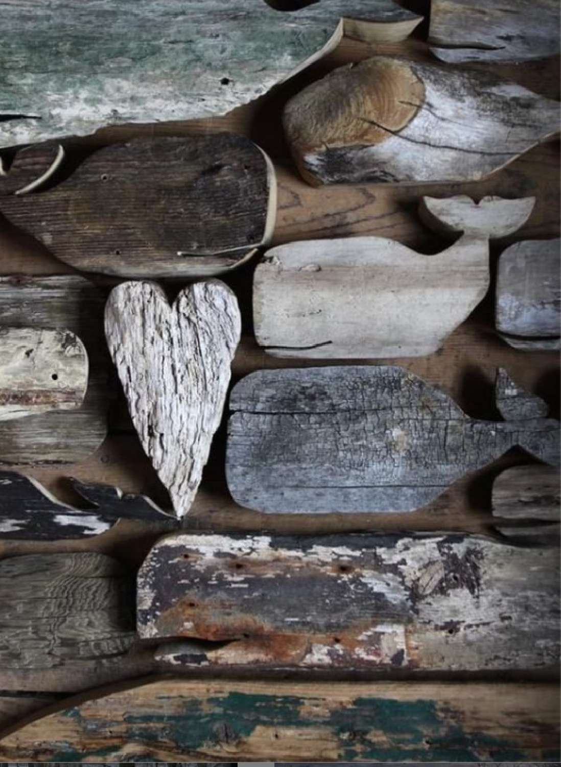 Massed collection of rustic wood whale shapes - Nora Murphy Country House. #countrydecor #whales #coastalstyle