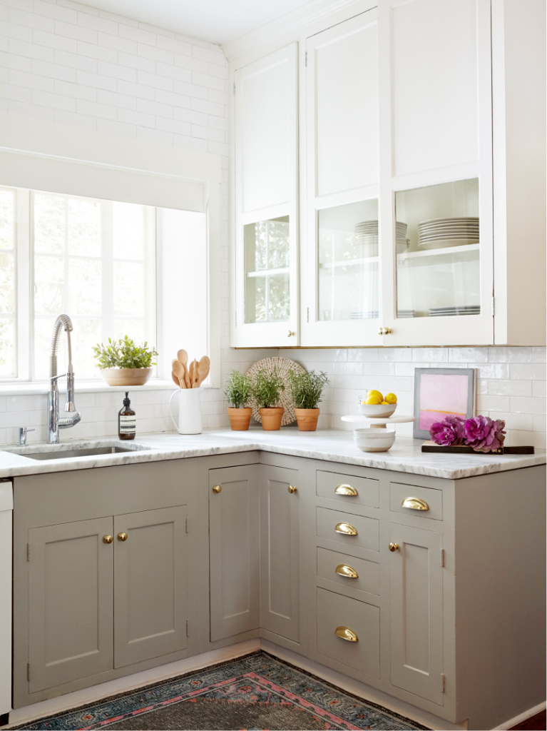 Gorgeous serene custom kitchen with putty base kitchen cabinets and white uppers - Stephanie Krauss Design. #kitchendesign #puttycabinets #greigekitchens #serenekitchen #interiordesign