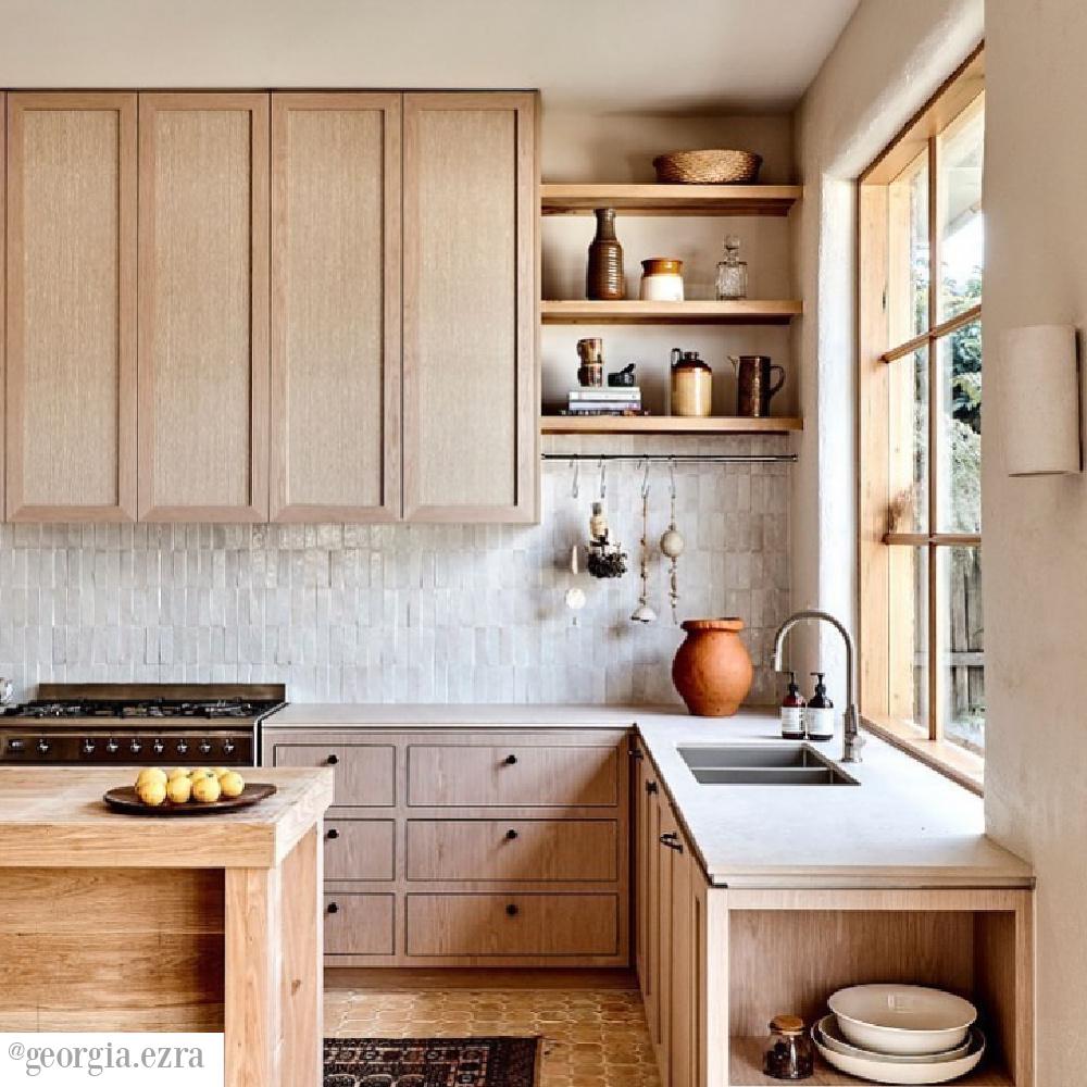 Zellige tile backsplash in a magnificent kitchen with light wood cabinets, open shelves, and a neutral palette - @georgia.ezra. #neutralkitchen #zelligetile
