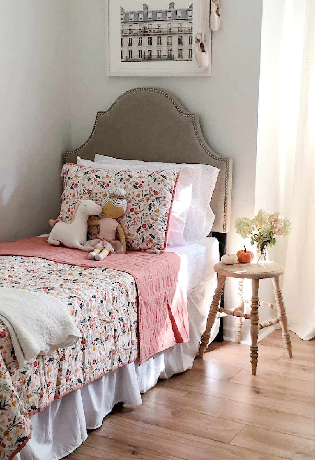 Floral quilt with dusty rose in a sweet bedroom with fall light - Hello Lovely Studio.